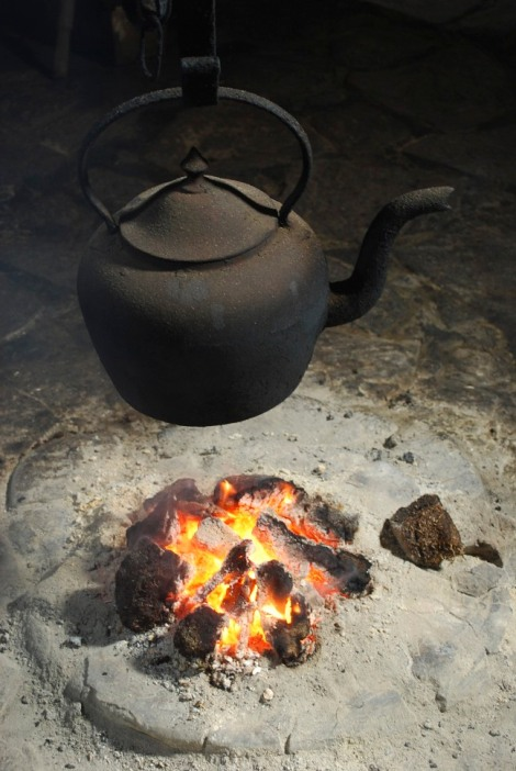 Kettle's on!  In the middle of the floor of the Arnol blackhouse, Lewis