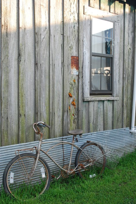 An old bike against a shack. Arty.