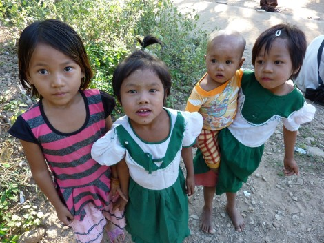 Burmese kids letting their curiosity get the better of them