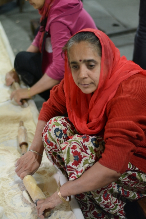 Chapati maker at Sheeshganj Gurudwara Sikh temple